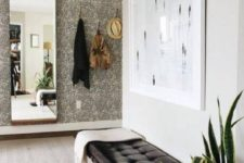 10 a classic black leather upholstered bench is ideal for a masculine entryway