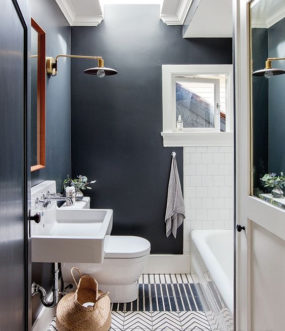 a rather dark bathroom is made cozier with skylights that flood it with light
