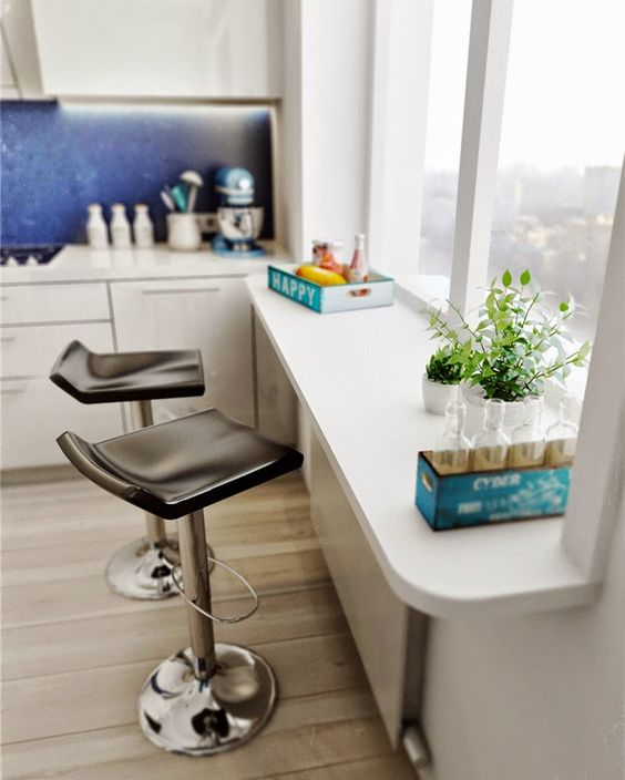 a small windowsill breakfast bar with a couple of modern leather stools