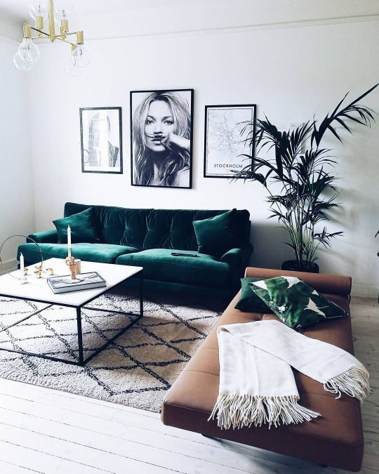 an emerald velvet sofa with matching pillows for a modern living room