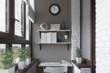 10 an industrial home office with grey walls, dark window frames and a faux brick wall, a floating desk and shelves