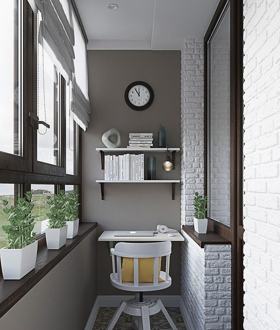 an industrial home office with grey walls, dark window frames and a faux brick wall, a floating desk and shelves