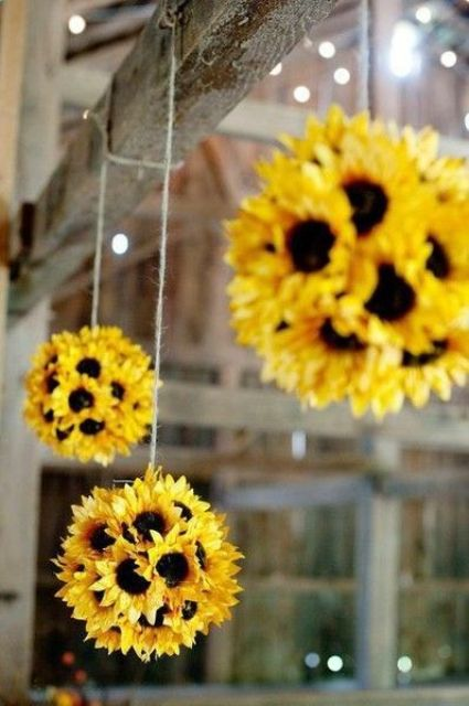 faux sunflower balls hanging over the window for a bright feel