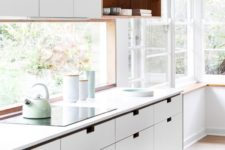 10 lots of windows and a window kitchen backsplash flood the kitchen with light