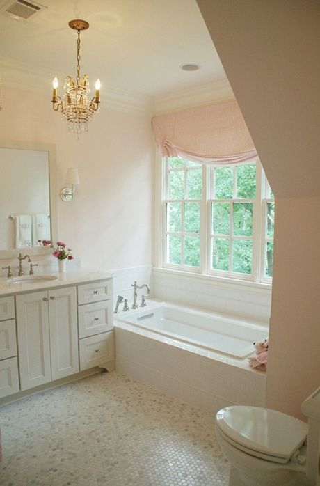 peaceful girlish bathroom with a small crystal chandelier and a blush curtain