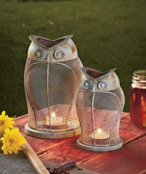 vintage owl-shaped candle lanterns can be used both indoors and outdoors