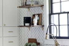 10 white herringbone tiles with black grout for a textural look in the kitchen