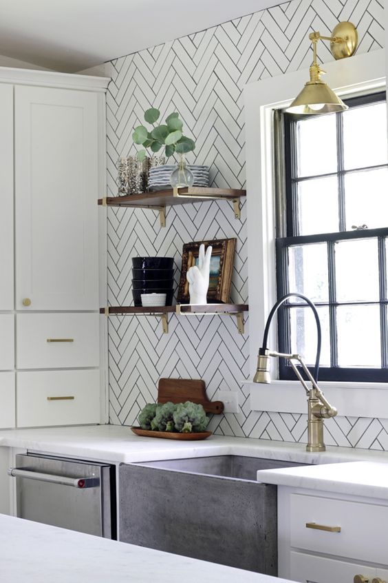 white herringbone tiles with black grout for a textural look in the kitchen