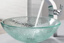 11 a broken glass sink in aqua color and a modern faucet for a chic modern look