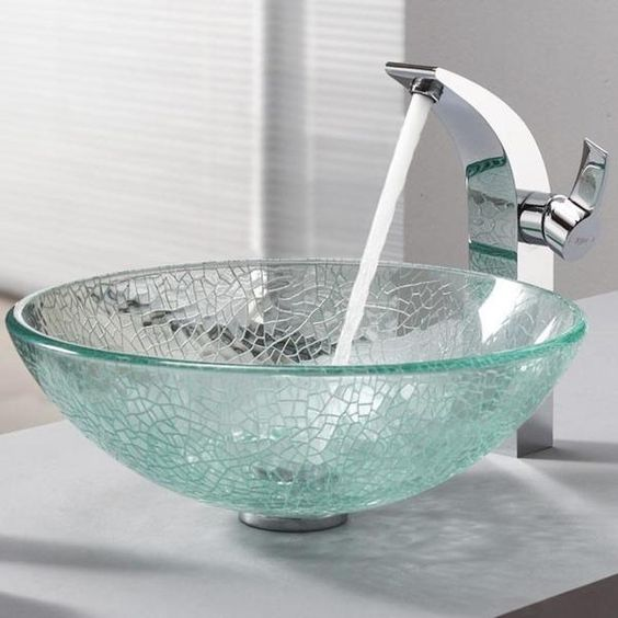 a broken glass sink in aqua color and a modern faucet for a chic modern look
