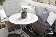 11 a corner pallet bench and a beautiful round forged table, potted greenery and plants