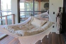 11 a hammock in the balcony is ideal for sleeping and will save much space
