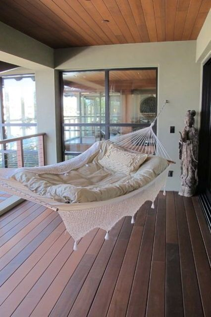 a hammock in the balcony is ideal for sleeping and will save much space