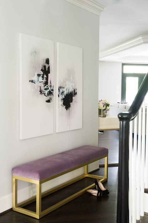 a lilac upholstery bench with brass framing for a girlish entryway