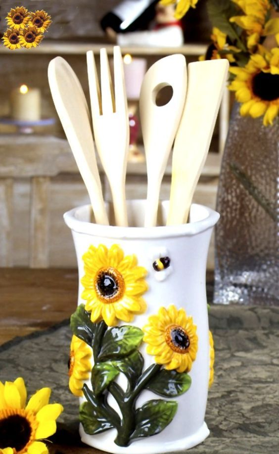 a utensil holder of porcelain with sunflowers is ideal for kitchens