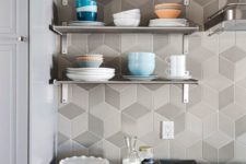 11 chic matte geo tiles in shades of grey highlight the kitchen decor