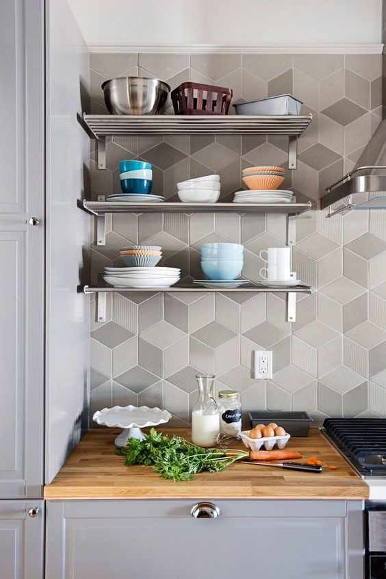 chic matte geo tiles in shades of grey highlight the kitchen decor