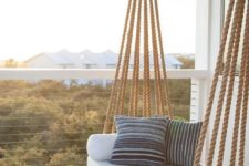 12 a hanging daybed suspended in the balcony is great for sleeping and relaxing