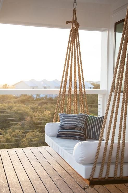 a hanging daybed suspended in the balcony is great for sleeping and relaxing