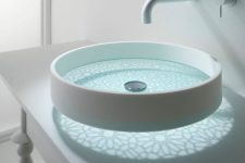 12 a round glass sink with frosted patterns and a white side
