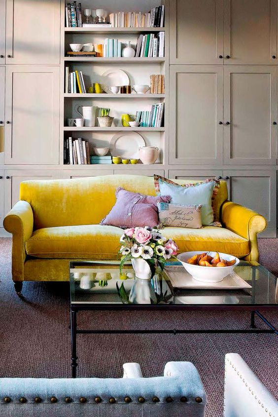 a sunny yellow velvet sofa to make a chic statement in a neutral space
