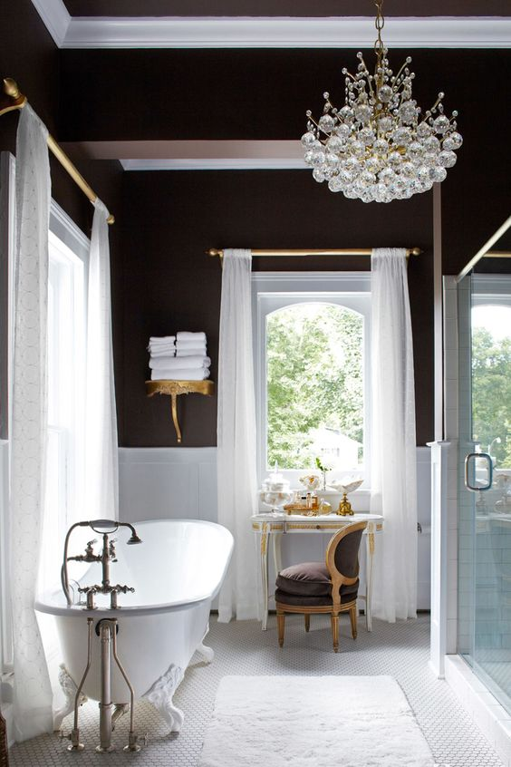 black and white bathroom with a free-standing bathtub and a crystal bubble chandelier