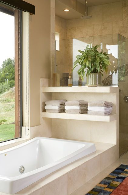 stylish open shelving next to the bathtub is a modern and comfy idea