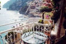 13 a glass table and forged chairs for a tiny breakfast nook in Positano