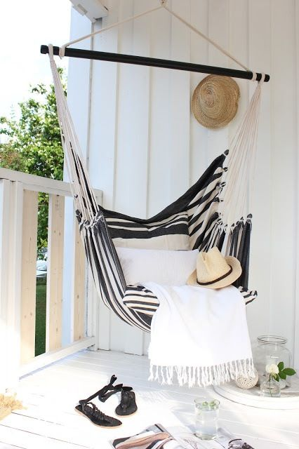 a hanging hammock chair for a cozy balcony - you may read here