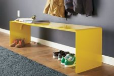 13 a modern lseek yellow bench will make a statement with its color and you can store shoes under it