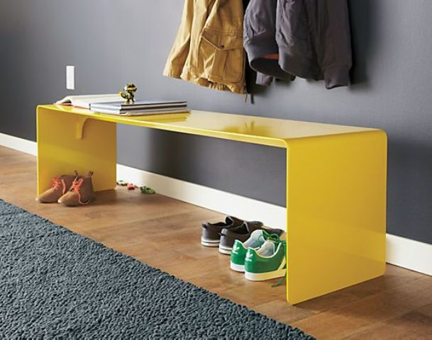 a modern lseek yellow bench will make a statement with its color and you can store shoes under it