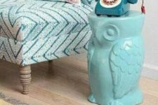 13 a turquoise owl-shaped side table is a fun idea for any space