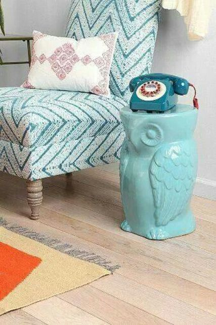 a turquoise owl-shaped side table is a fun idea for any space