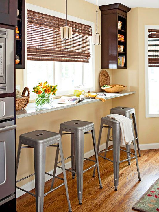 a windowsill breakfast bar and metal stools look very inviting and cozy
