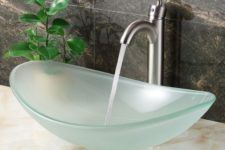 13 an oval-shaped frosted glass bathroom sink is a chic idea