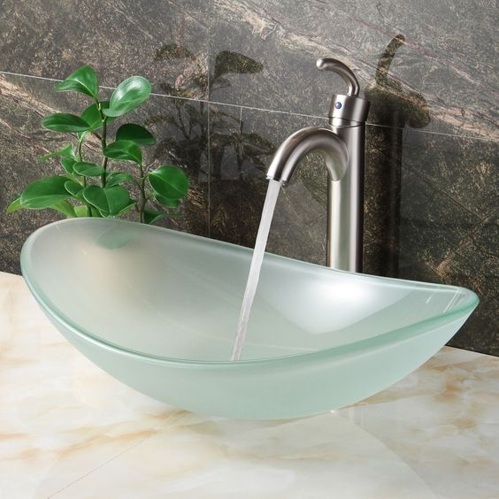 an oval-shaped frosted glass bathroom sink is a chic idea
