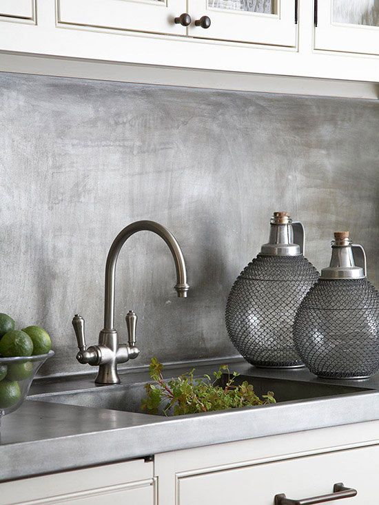 burshed metal kitchen backsplash looks textural and adds interest to the kitchen