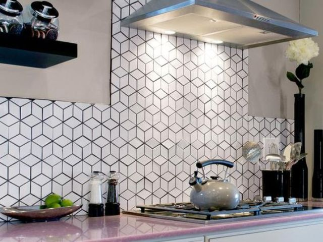 cube inspired white tiles with black grout stand out and make the kitchen look cooler
