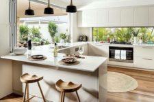 13 minimalist creamy kitchen with a foladble window and a window backsplash