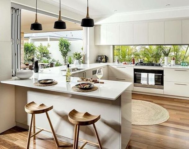 minimalist creamy kitchen with a foladble window and a window backsplash