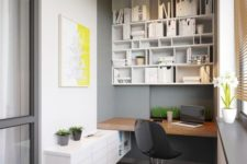 13 stylish home office with a floating desk, a large shelving unit, a floating cabinet and a window sill
