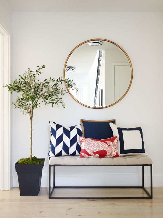 a neutral upholstery bench with black framing is great for most of modern entryways