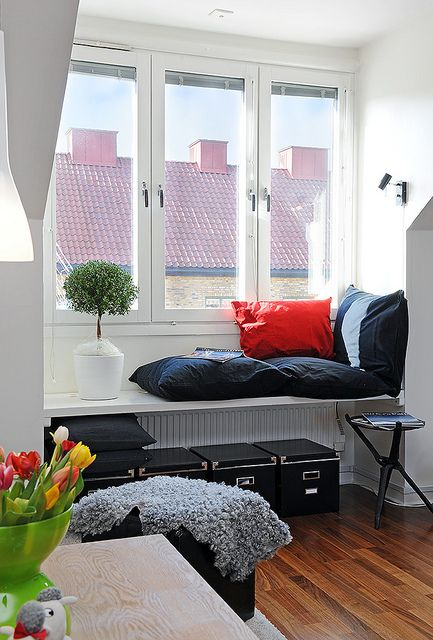 a window sill daybed ade of pillows and cushions is an ideal place to sleep