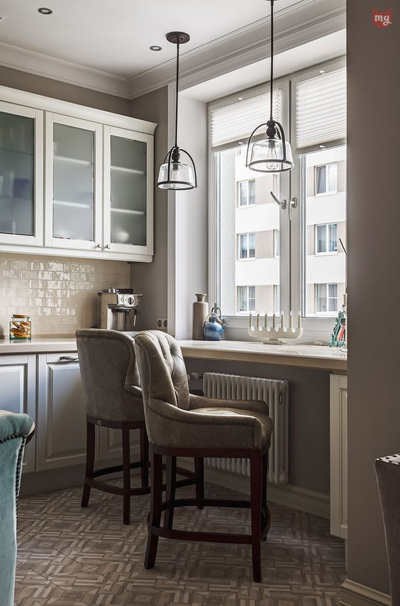 a windowsill for breakfasts and a couple of comfy upholstered chairs