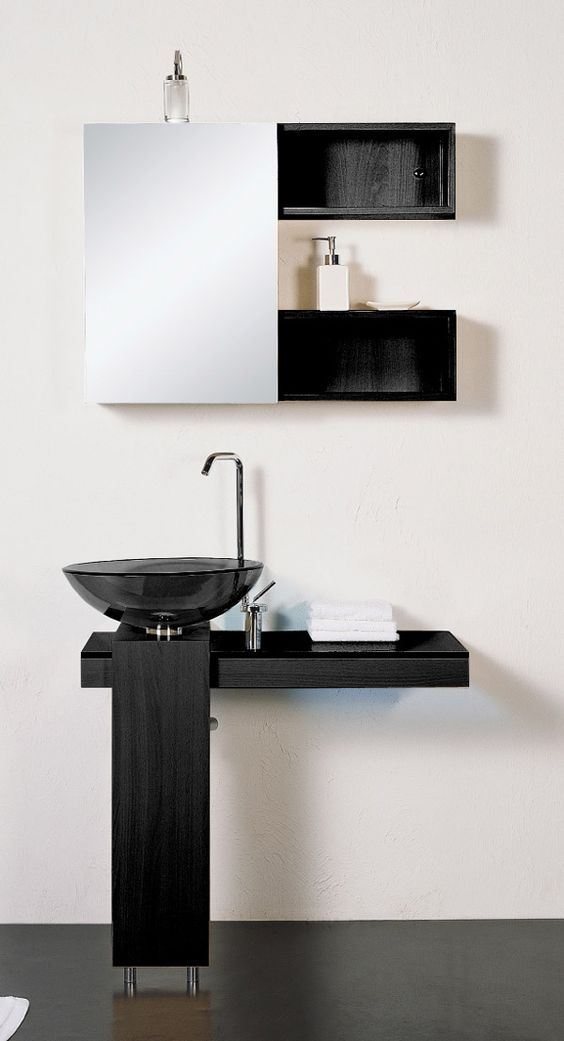 Simple an ultra minimalist bathroom with a smoked glass sink