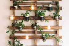 14 candle lanterns attached to a wooden trellis on the wall won't take any space