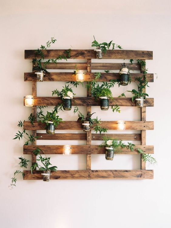 candle lanterns attached to a wooden trellis on the wall won't take any space