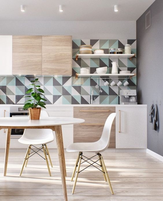 geo triangle tiles in grey, aqua and white adds a colorful splash to the neutral kitchen