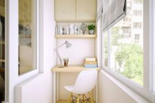 14 tiny neutral balcony with cabinets, an open shelf and a tiny desk for studying and working