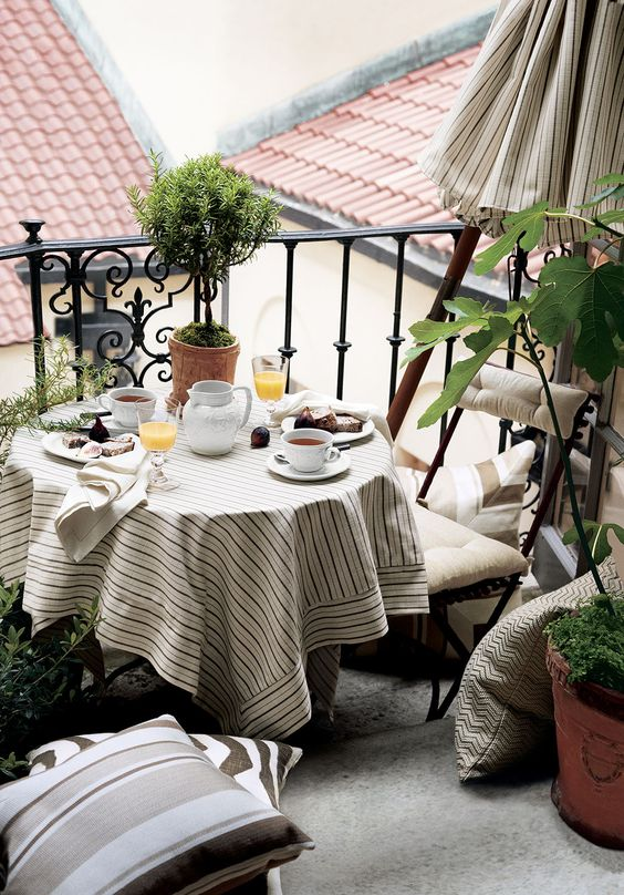 a table and upholstered chairs for a cozy breakfast nook, add pillows